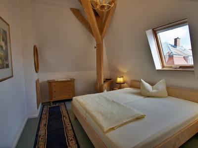 Schlafzimmer - Dachgeschoss Wohnung Fux Altstadt Appartements