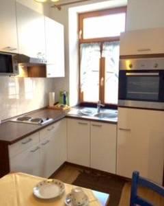 Kueche - Apartment mit 1 Schlafzimmer - Fux Altstadt Appartments Augsburg